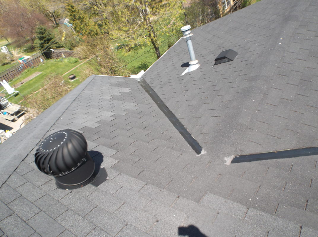 Roof Shingles Replaced at different times.
